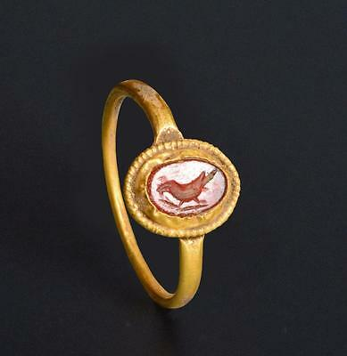 Roman gold ring with perched bird intaglio: 2nd-3rd century AD.