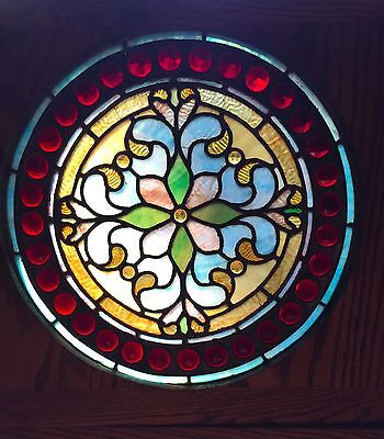 1 of a matched pair of jeweled stained glass windows