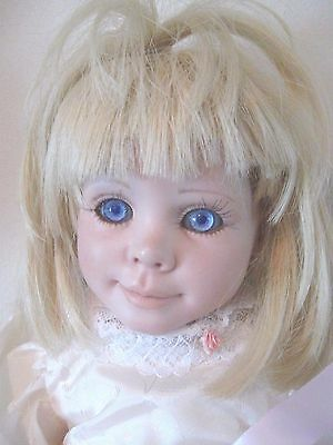 Vintage Porcelain  Artist Made doll Completed with outfit and Violet eyes
