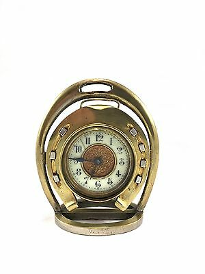 Antique horseshoe clock, by the British United Clock Co