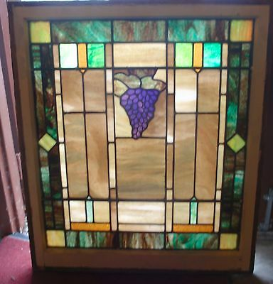 1 of a pair of grape stained glass windows