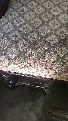 Old mahogany arm chair with tapestry covering