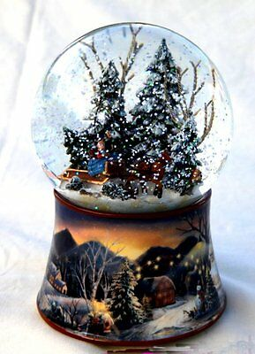 Musical Snow globe with family riding in a horse drawn sleigh