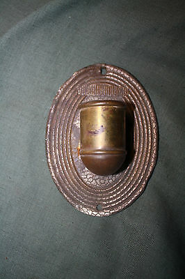 Early wall mounted candle stick holder