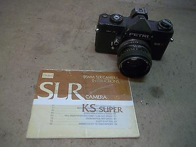 Old Petri SLR 35 Camera with 50mm 1:1.8 lens & booklet