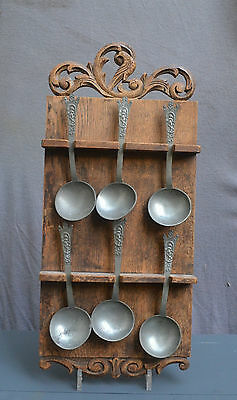 Six Antique spoons with a figure decor on a spoon rack crowned rose mark 18 19C