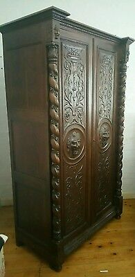 A Renaissance Style Carved Wood Armoire With Carved Lion Heads Masks