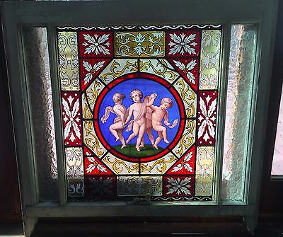 Dancing  putti stained glass window