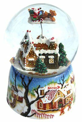 Musical Snow globe -  features Santa in his sleigh flying above the houses