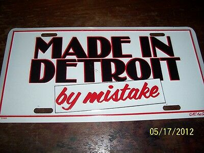 I LOVE MADE IN DETROIT by mistake,METL MOULDED LICENSE PLATES,MADE IN USA.
