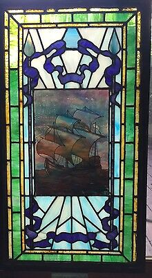 Antique stained glass window featuring whaling ship
