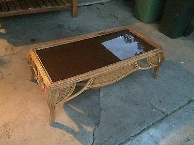 lowline cane coffee table with glass top