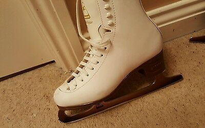 ice skates size 7, with blade covers,  skate covers and bag