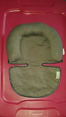Grey Infant head support for the car seat