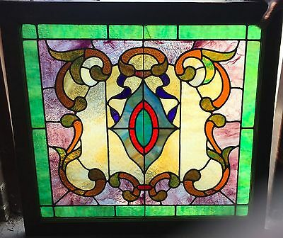 Vibrant colorful antique stained glass window