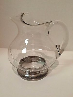 Glass pitcher with sterling silver base