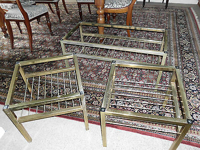 COFFEE TABLES, nest of 3 smoked glass toped