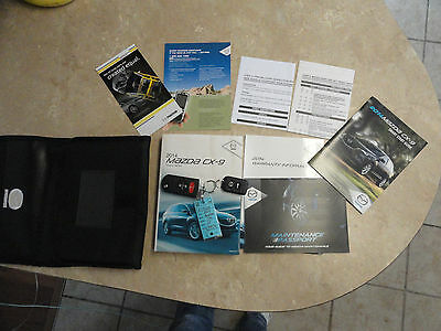 2014 Mazda CX9 owners manual and key fobs F14220