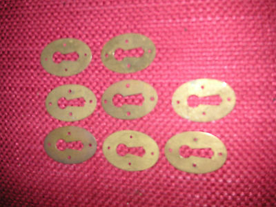 Eight round slightly domed Brass Door Keyhole plates,  (18)