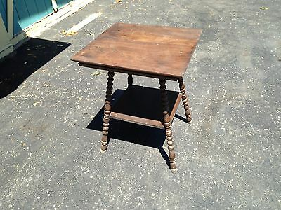 Antique two tier decorative wooden table with spindle legs nice vintage piece