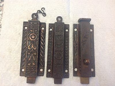 Antique Eastlake spring loaded door latches, 3 in total, not matching
