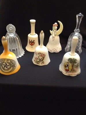7 Vintage Bells including Enesco, Cook family crest, Texas and others