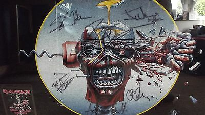 Signed Iron Maiden T Shirt professionally framed in black with vip pass.