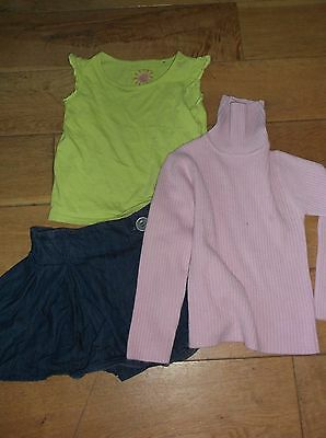 Next denim skirt 5 years with pink polo neck jumper. 5-6 years. Green t shirt 5