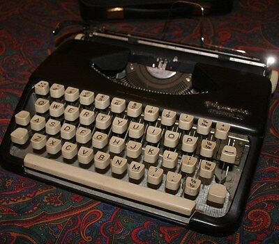 Vintage early Olympia Splendid 99 portable typewriter 1959 working with case