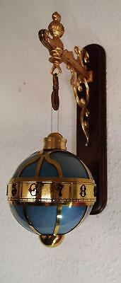 Vintage novelty brass & enameled rotary ball gravity wall clock and bracket