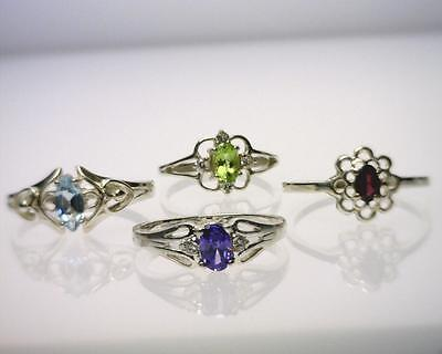 Sterling Silver Lot of 4 Rings with Different Gemstones. (B3240)