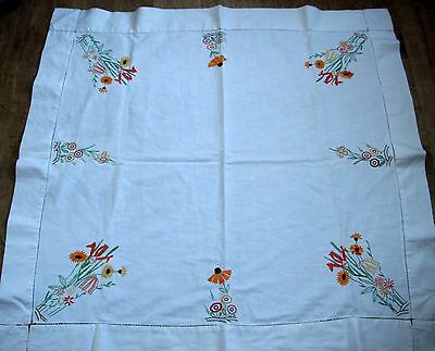 Linen tablecloth with hand embroidered orange & lemon flowers to each corner