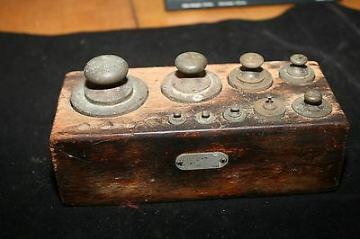 Antique brass scale weights in wooden box