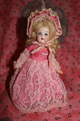 Vintage bisquehead/compo. body doll, pink lacy dress, 9""