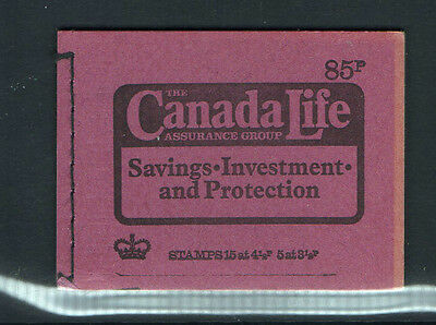 1974 QEII STITCHED 85p DW1 STAMP BOOKLET / CANADA LIFE PURPLE COVER - MINT