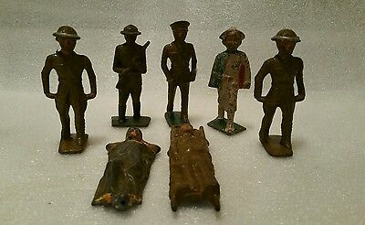 7 lead WW1 Military figures. Nurse, 2 stretchers, 4 soldiers