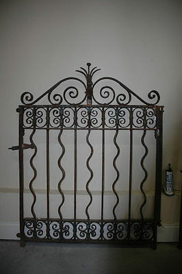 Heavy antique wrought iron gate bought in Greenwich Ct in 1980 was antique then.