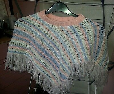 Girls poncho in pink, blue & white with tassles - size small, 100% acrylic