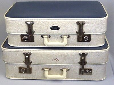 A Pair of Vintage Vanguard Expanding Suitcases