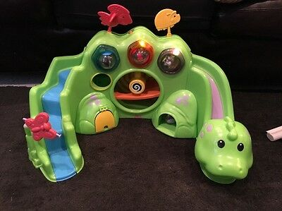 Fisher Price DROP AND ROAR DINOSAUR with 12 Roll A Round Balls Lights and Music