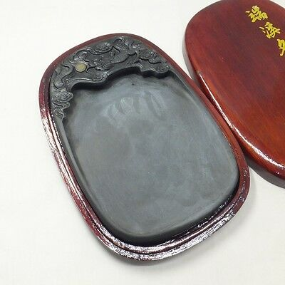 D101: Chinese calligraphy tools. Sculptured ink stone of TANKEI style with case