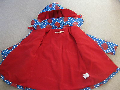 Designer fleece lined girls raincoat Age 4-5 years Blue dots/red apples