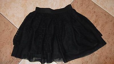 Lovely girls lacey black puffed out party skirt layed