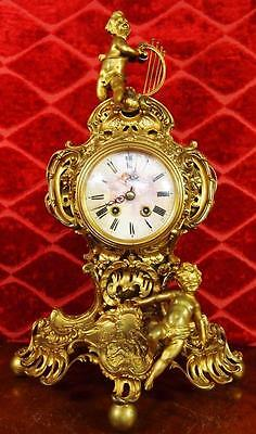 Antique 19th c French gilt pierced bronze 8 day figural Roccoco mantel clock