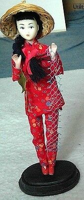 China Dolls collector doll on stand fisher woman traditional clothing plastic