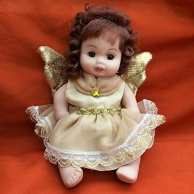 Classic Creations Porcelain Angel Doll In Gold With Gold Birthstone