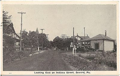 Looking East on Indiana Street in Seward PA Postcard Gas Station
