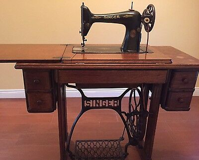 Antique Singer Treadle Sewing Machine in 4 drawer cabinet/desk, iron base