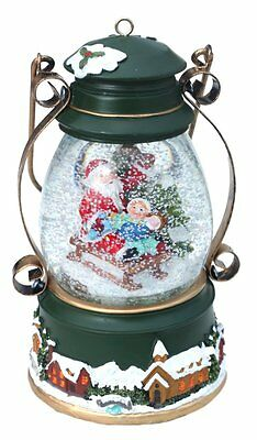 Musical lantern snow dome featuring jolly Santa with child on sledge
