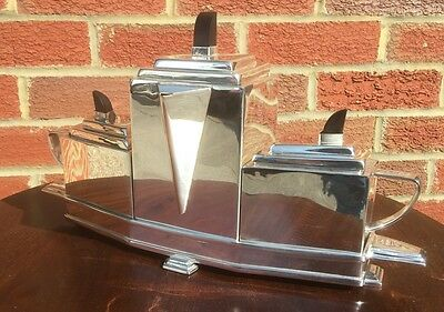 In The Style Of Christopher Dresser Silver Plate Tea/coffee Set. Open To Offers.